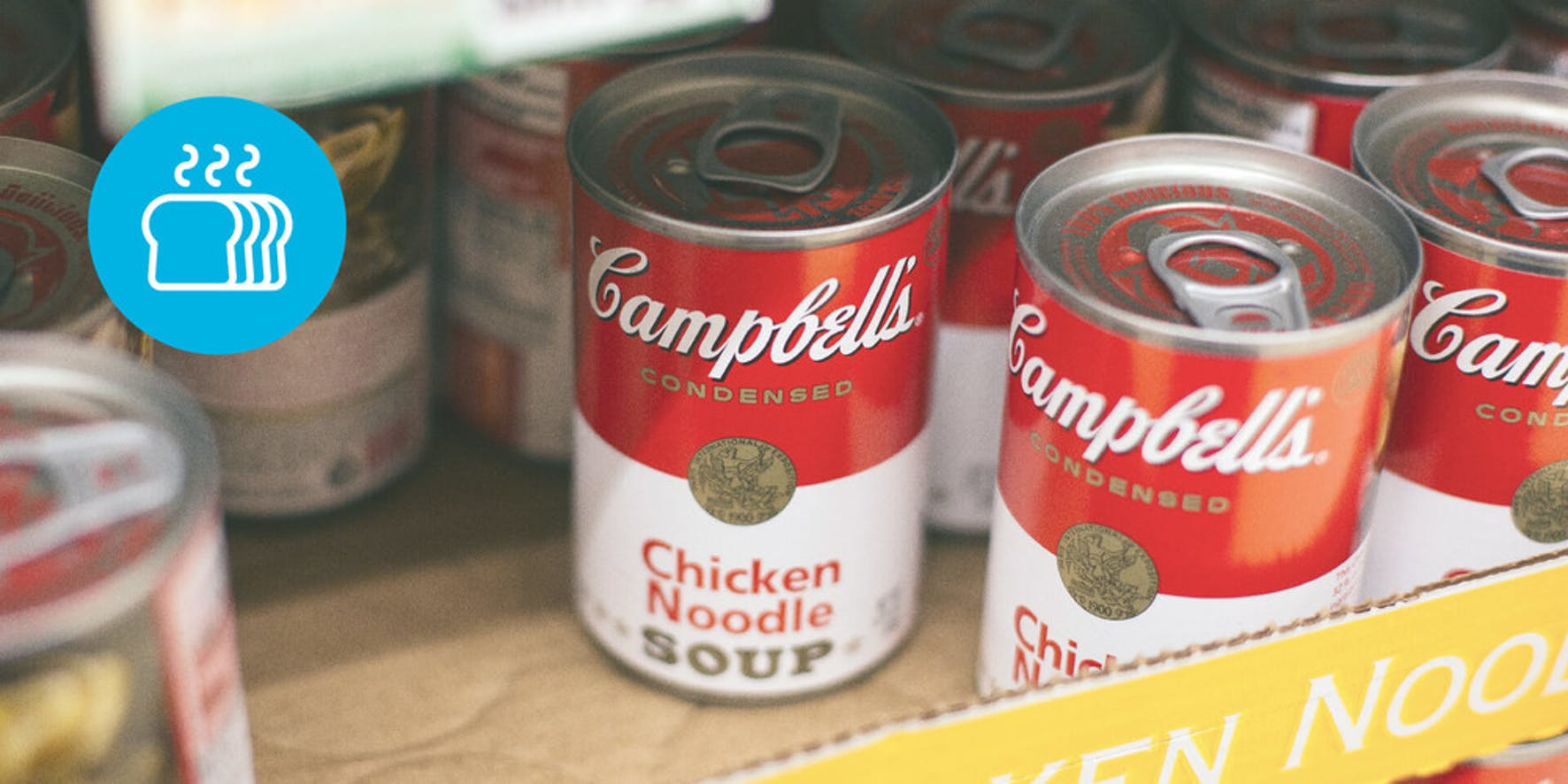 Campbell's chicken noodle soup in a box on a shelf in the grocery store