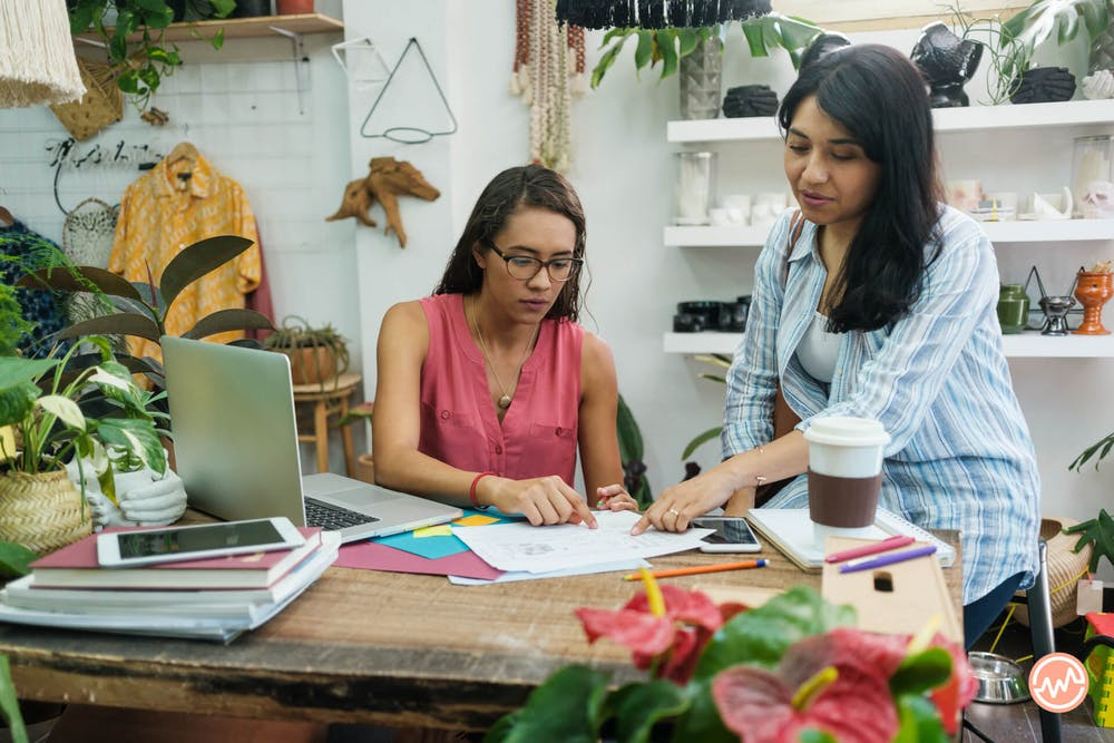 Two business owners looking at their business credit reports