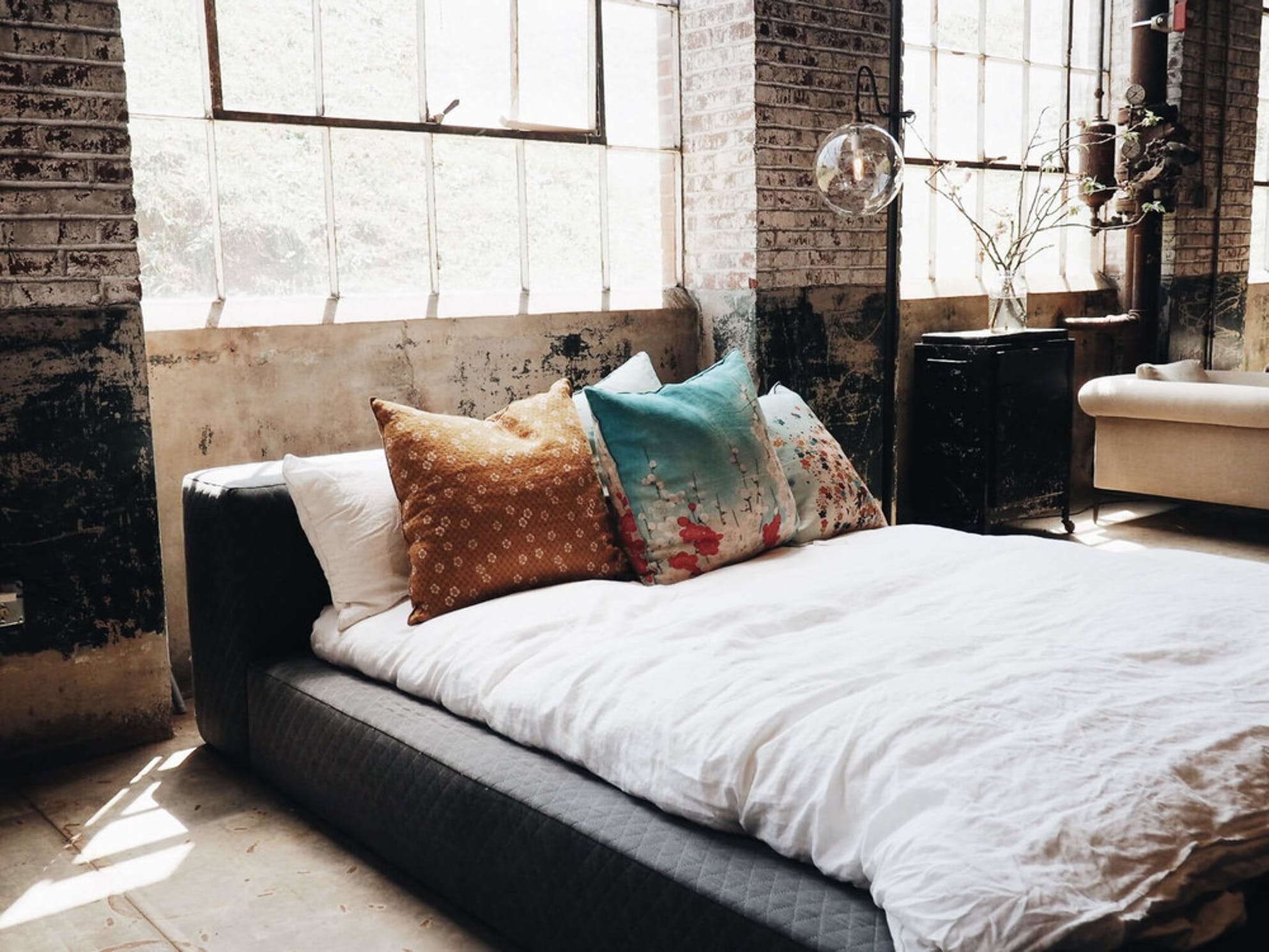 weak sleep on a bed with pillows