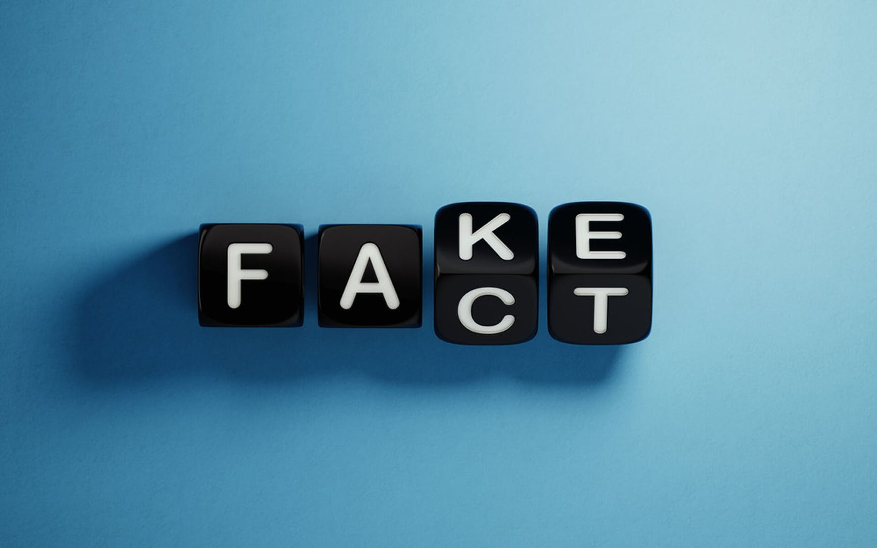 letters are spelling out word the word fact to debunk credit myths