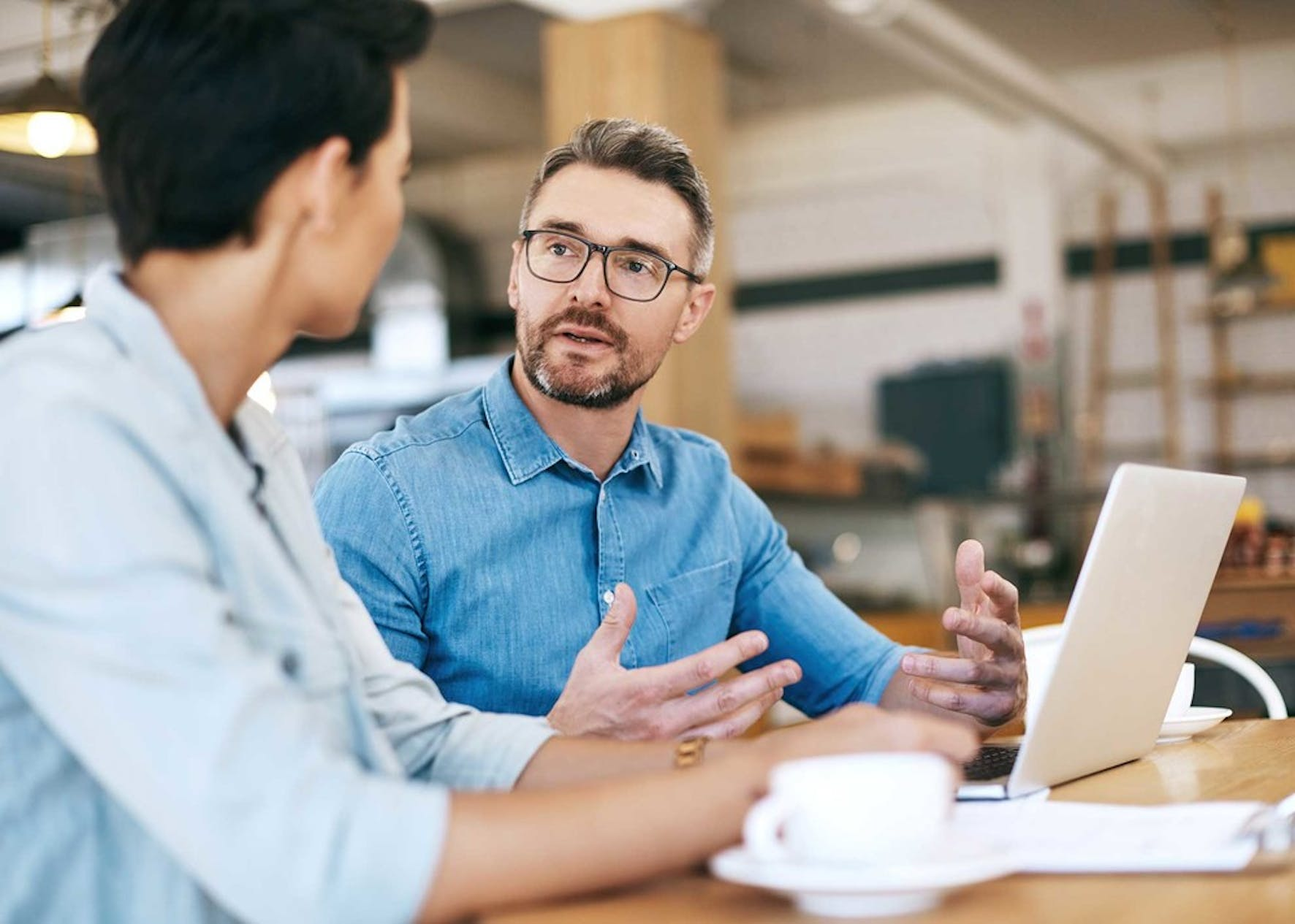 Man practicing leadership skill with coworker.