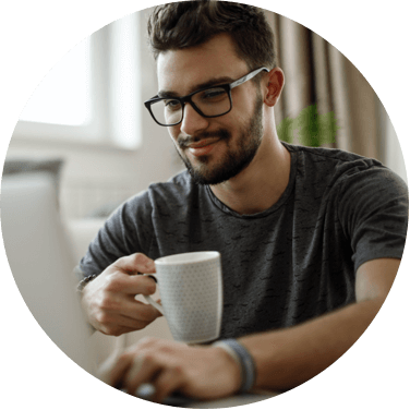 Person looking at class content while sipping cup of coffee