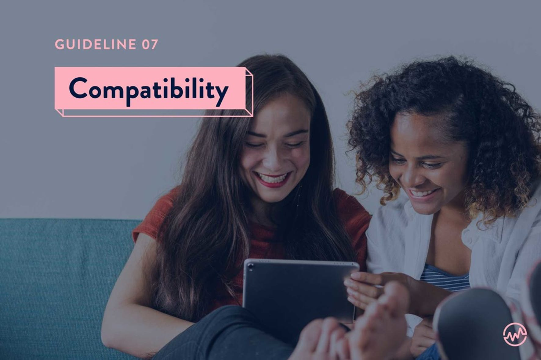 Two female friends looking at compatibility scores on an iPad who plan on buying a house together
