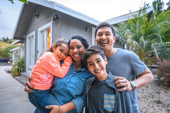 A family after learning how to buy a house without a realtor