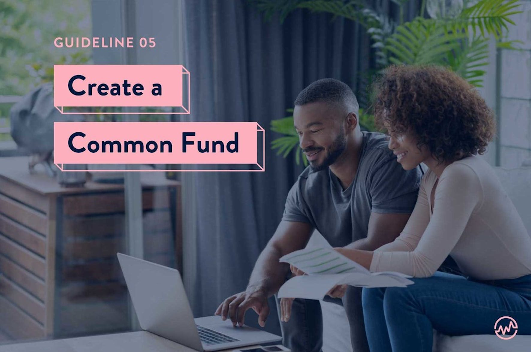 Two friends looking at a computer discussing creating a common fund for buying a house together