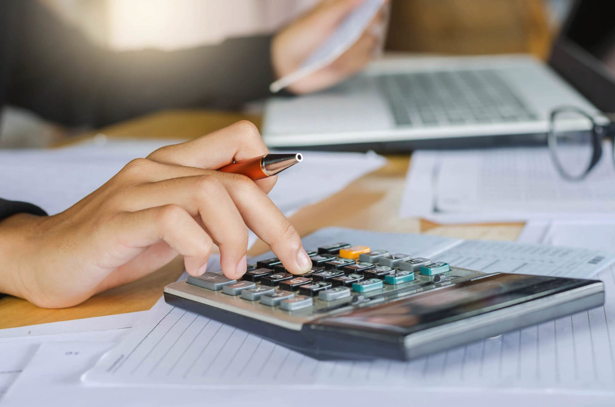 Woman calculating an example of FHA loan expenses