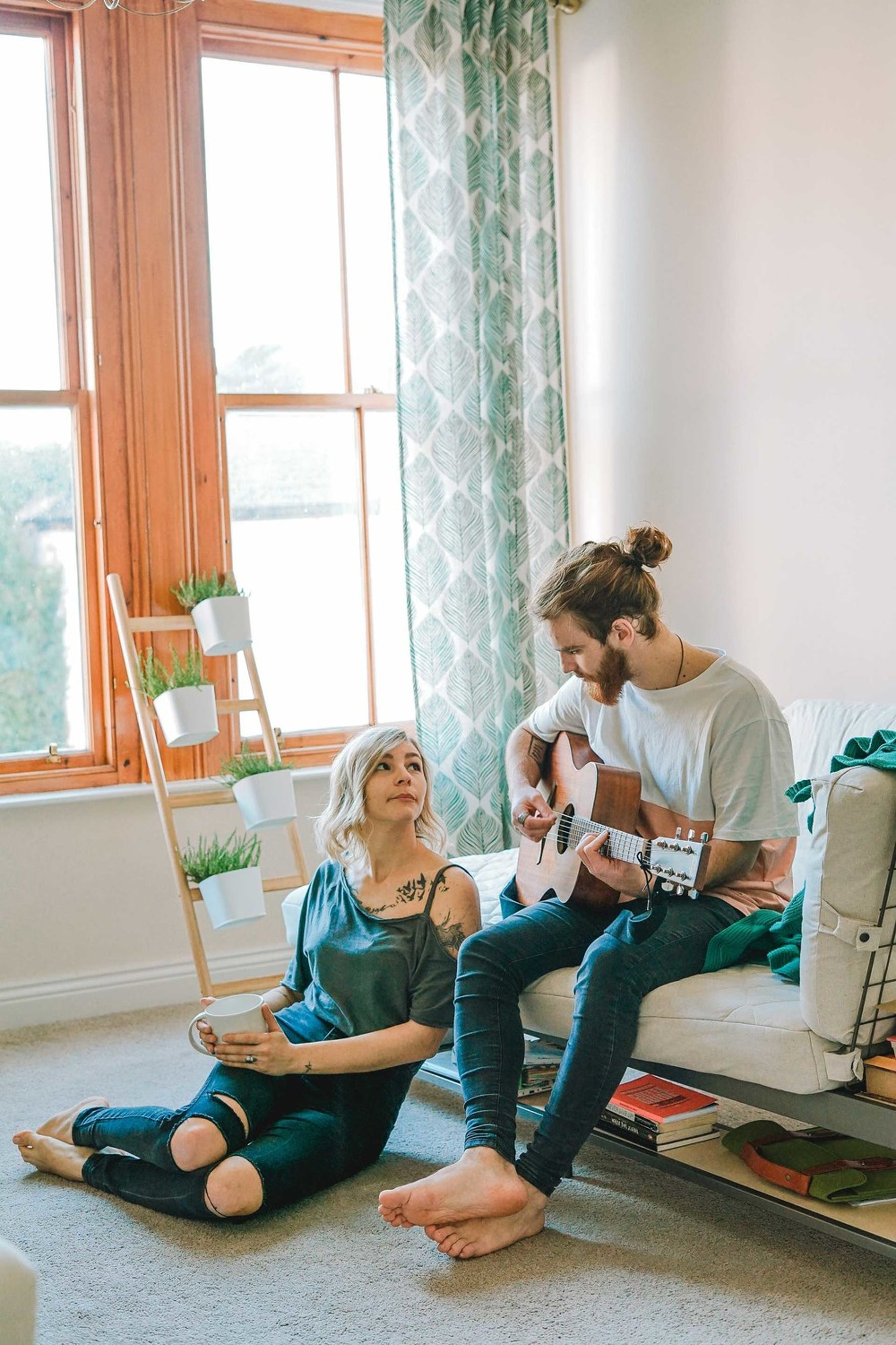 A married couple living within their means in a small apartment as they pay down student debt