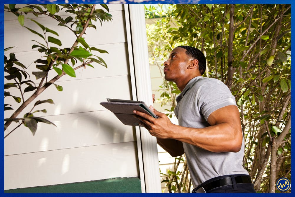 A real estate investor examining a property in foreclosure.