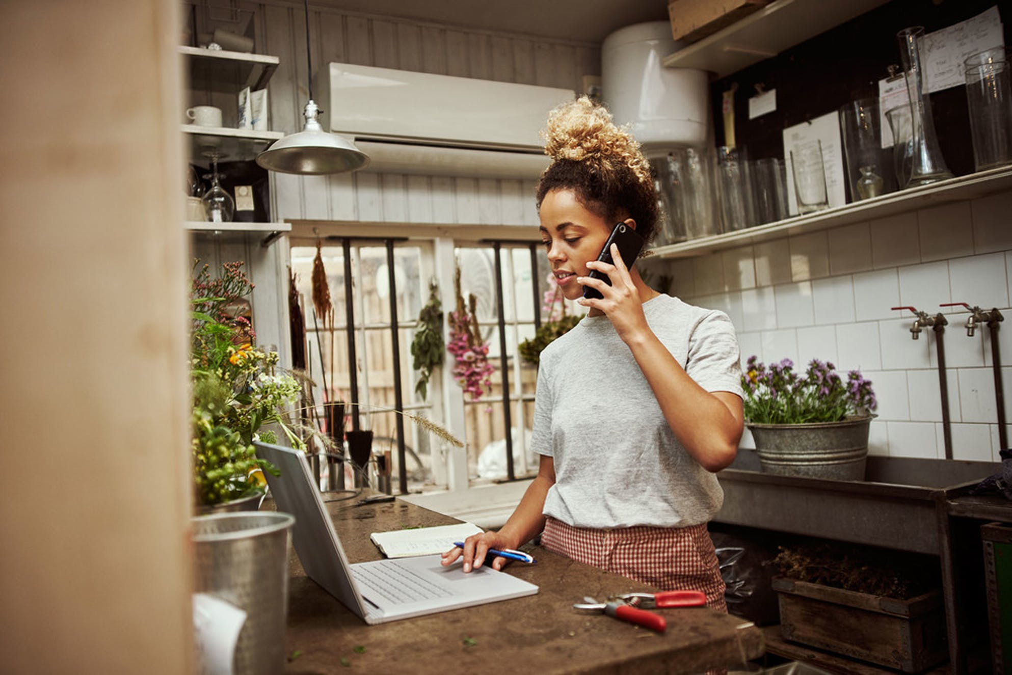 what to do with your tax refund: a woman investing in her business