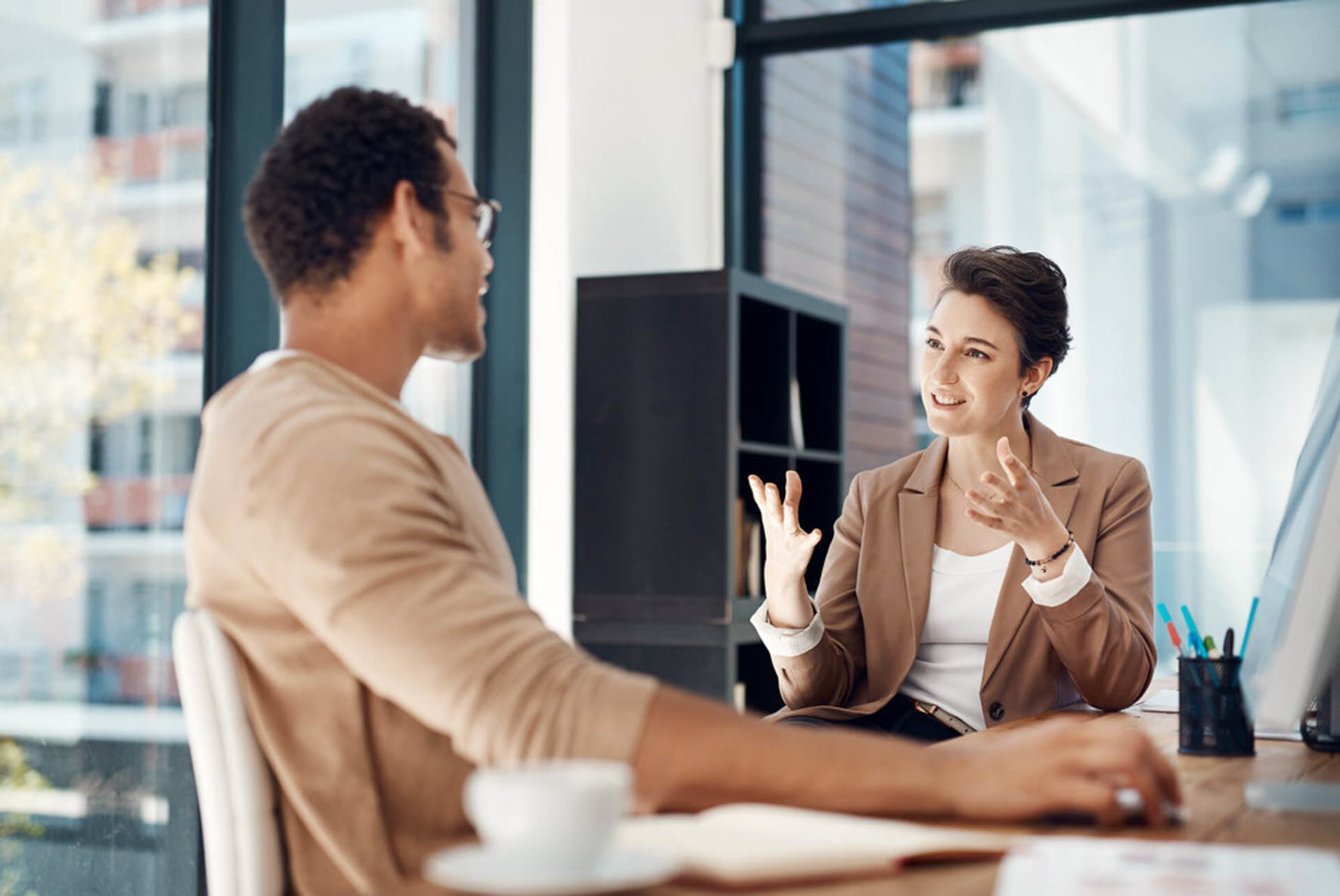 Two people discussing buying tradlines to improve their credit scores