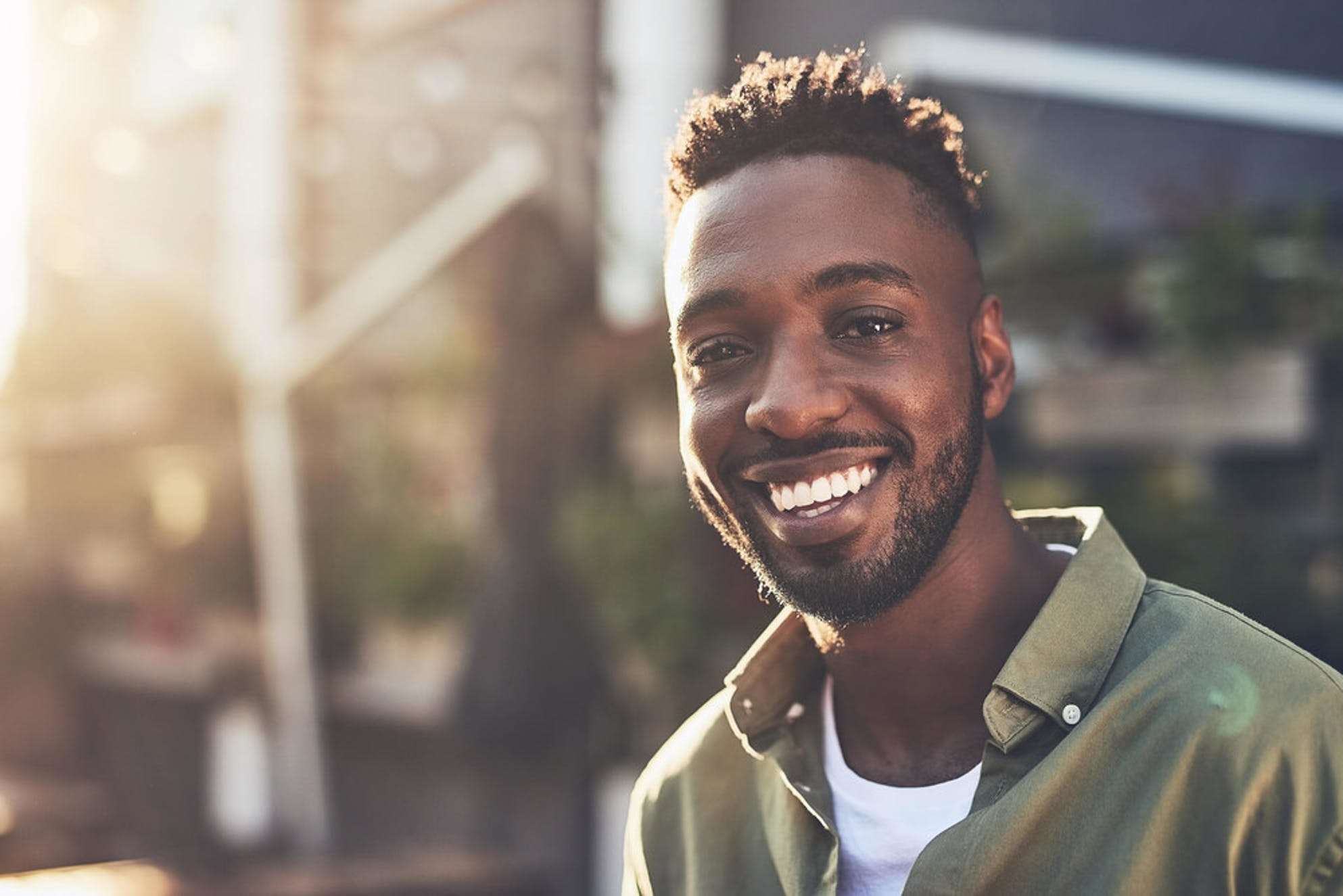 Man smiling because he kickstarted retirement in his 20s