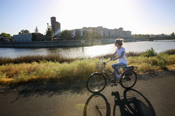 Person cycling by river