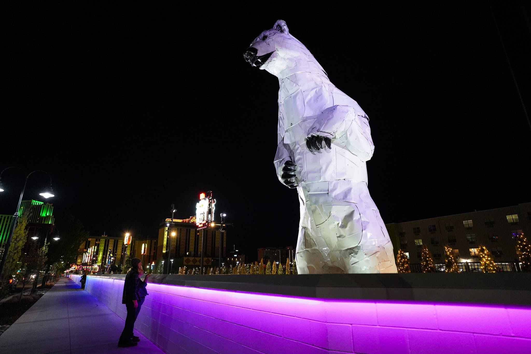 giant polar bear sculpture on neon line Reno