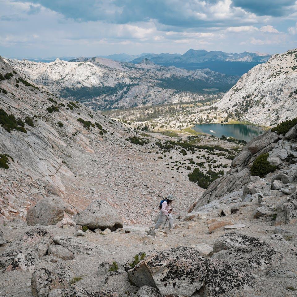 Hiker going up to Vogelsang Peak