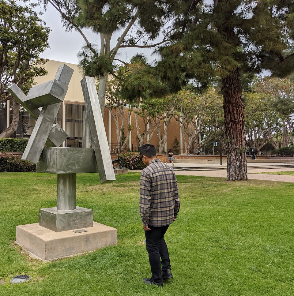 Person looking at an outdoor art installation at UCLA in Los Angeles