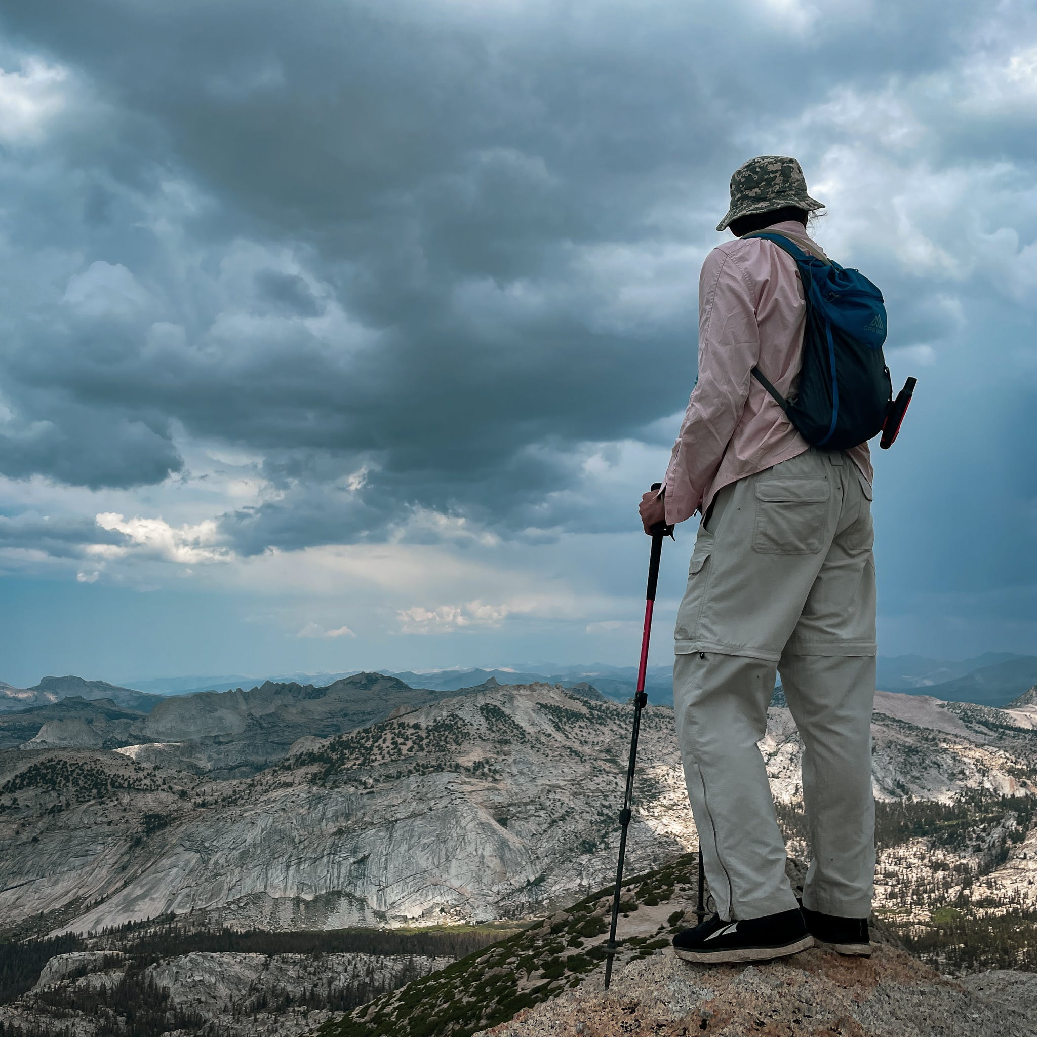 hiker at the summit of Vogelsang Peak in Yosemite