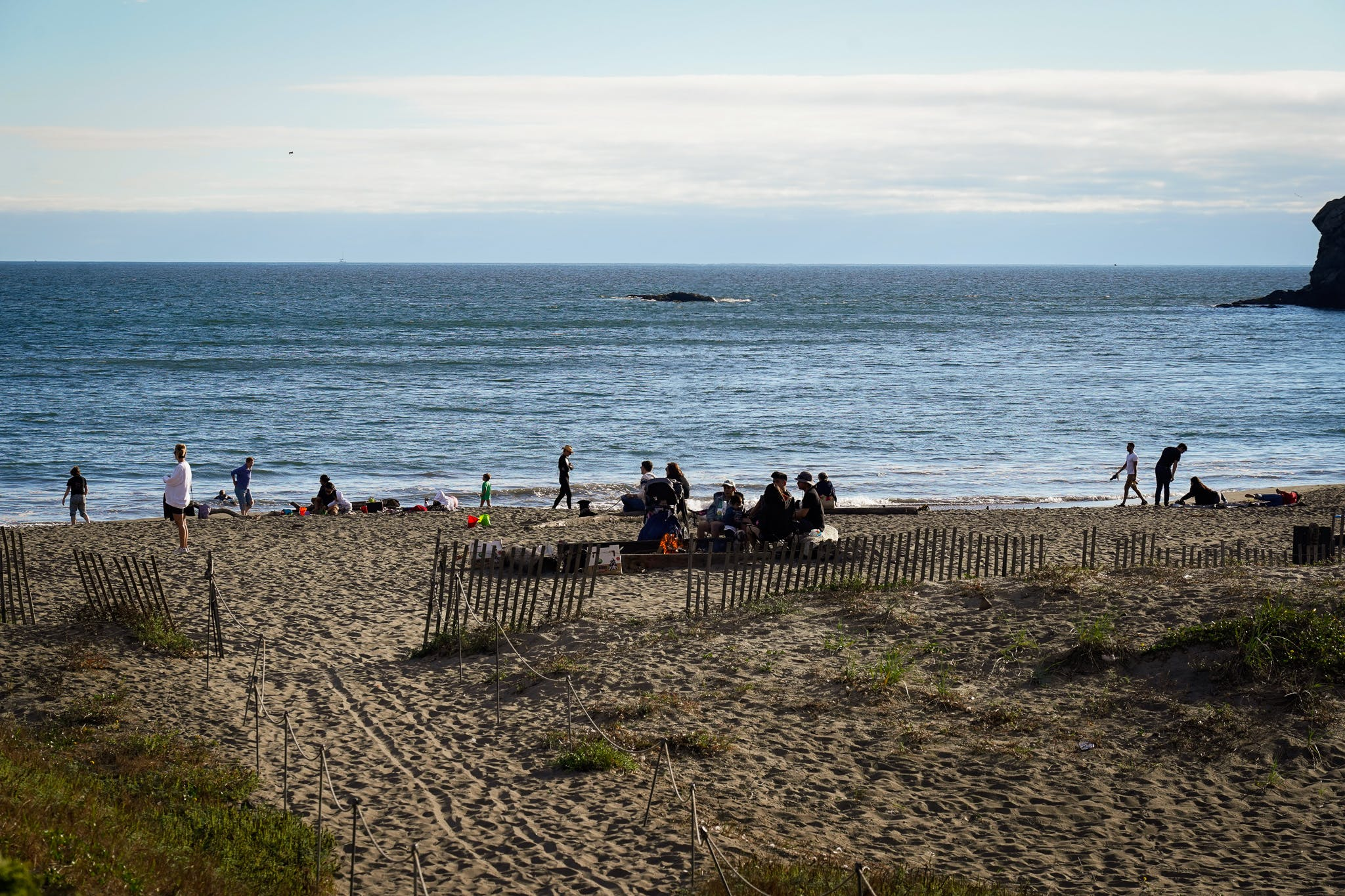 people relaxing at Muir Beach in Marin