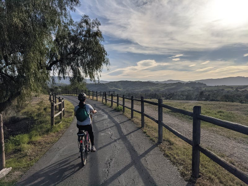 Woman biking the riverside bike trail from Ventura to Ojai