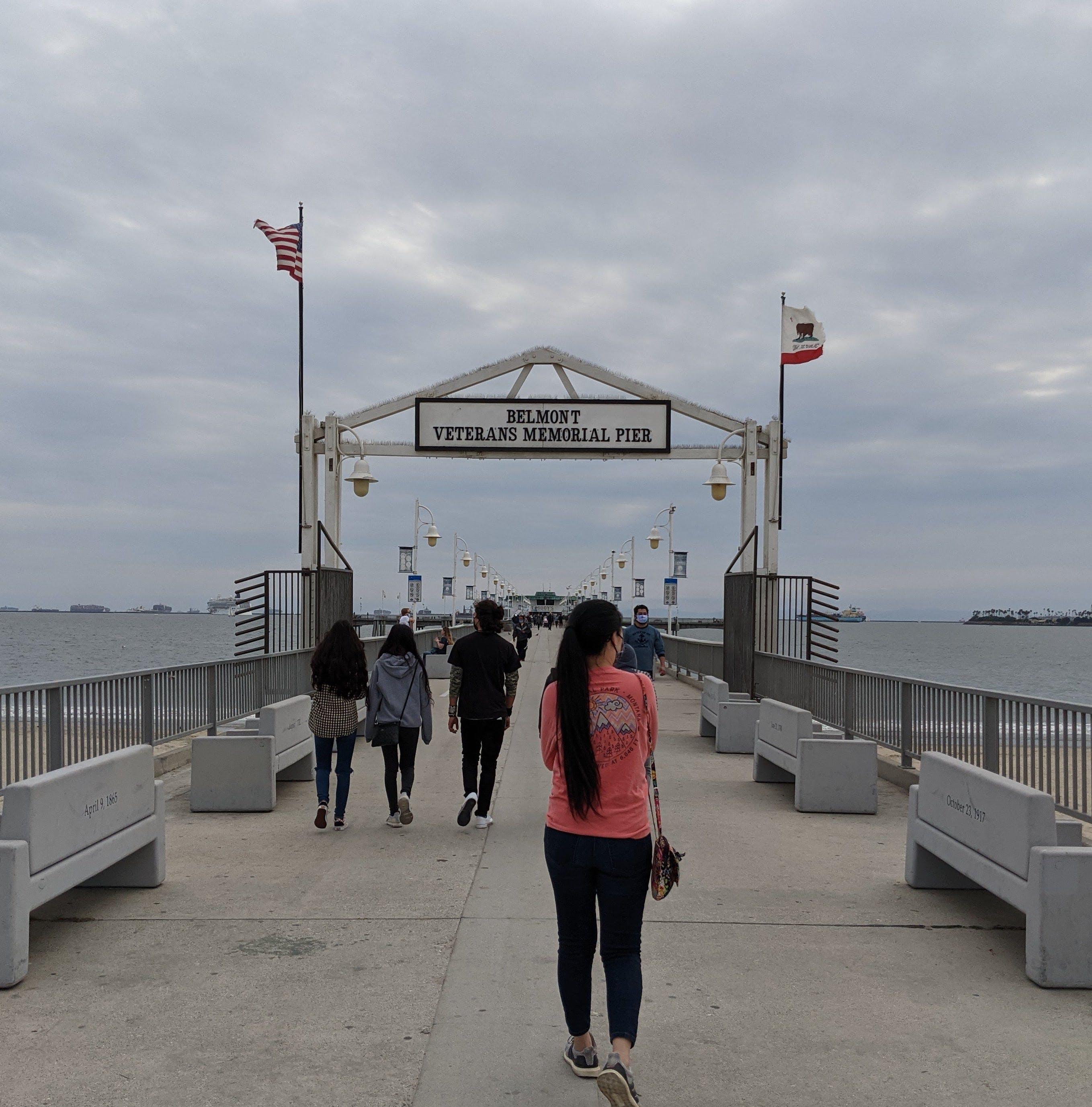Woman walking at Belmont Pier Memorial in Long Beach