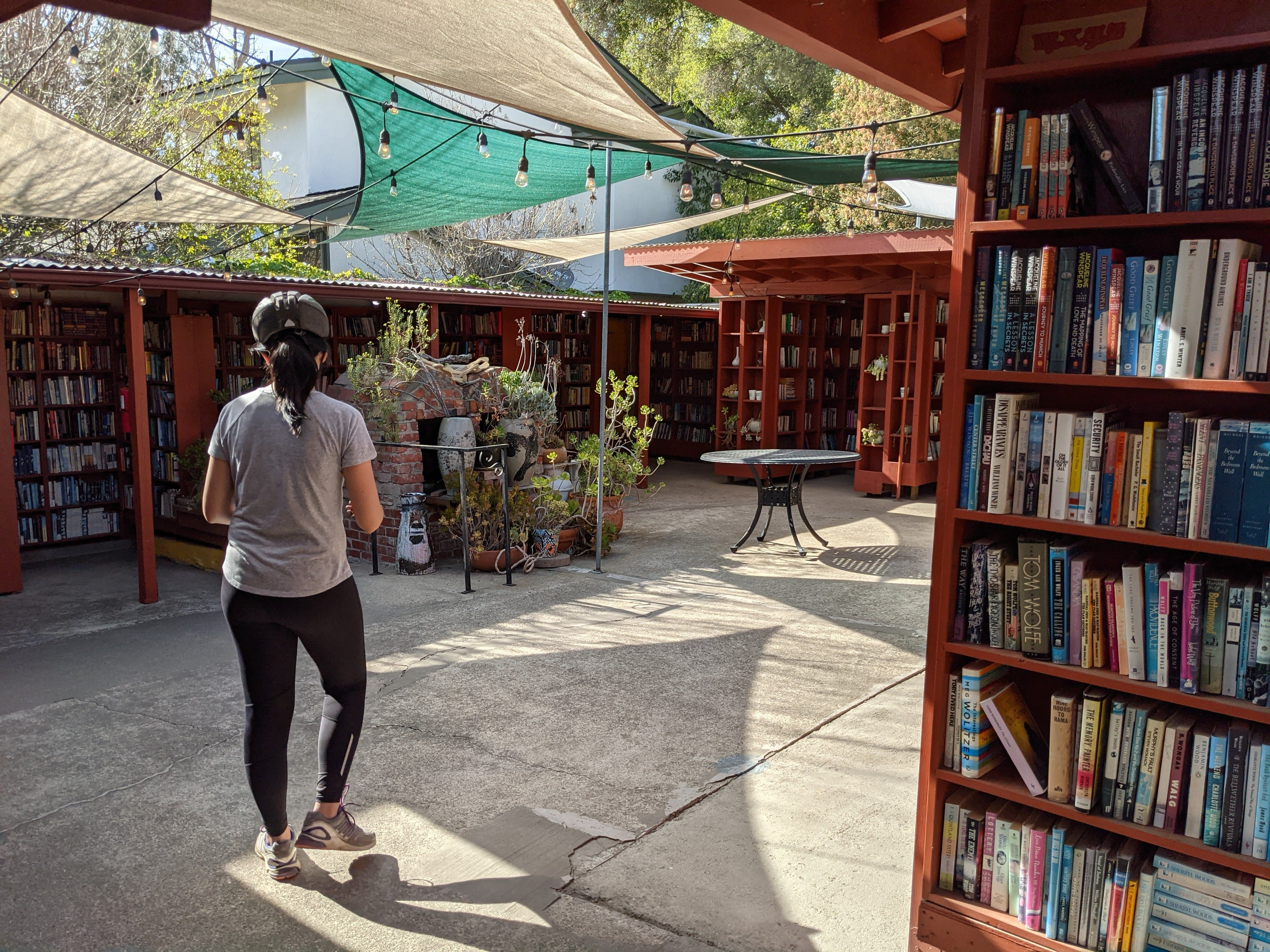 Woman walking around looking at the books in the outdoor bookstore Barth's Books in Ojai California