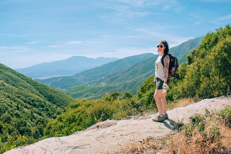 Woman standing and overlooking the scenery at Marshall Peak in San Bernardino National Forest