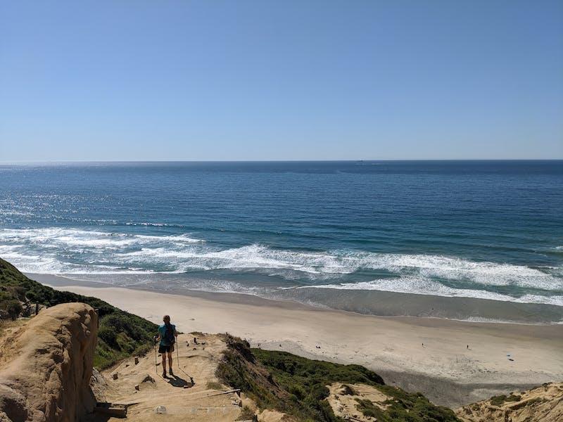 Woman walking down towards Blacks Beach in La Jolla