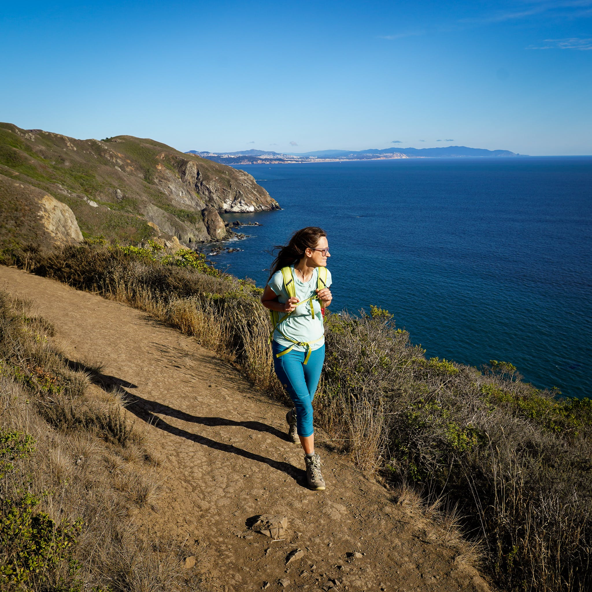 Woman hiking along the Coastal Trail in the Marin Headlands