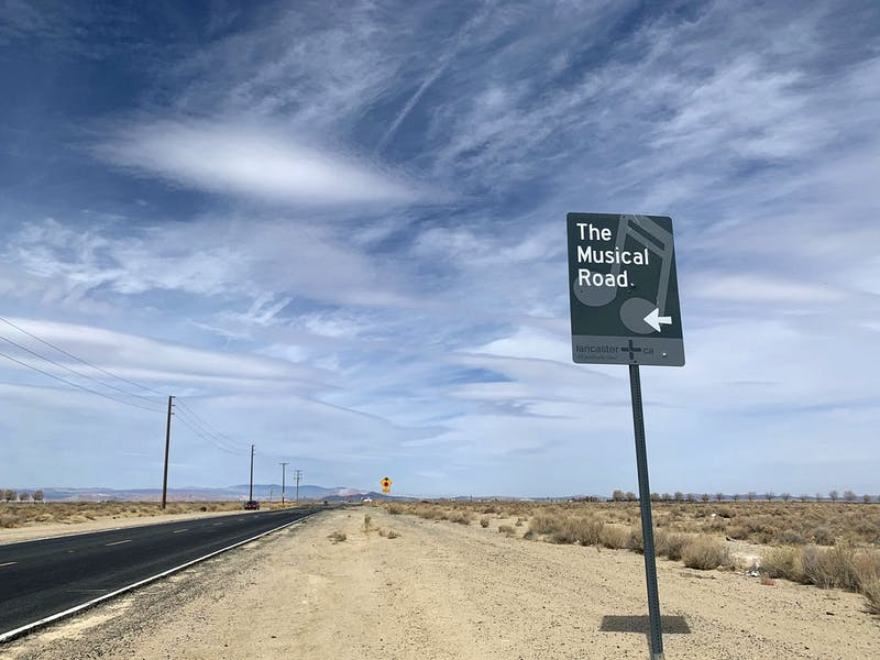 Sign reading The Musical Road and showing the road in Antelope Valley
