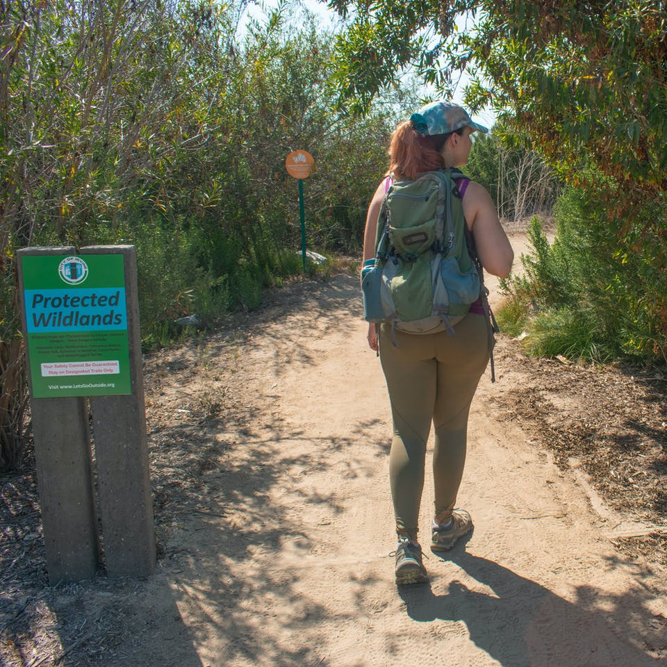 Hiker starting on the Bommer Canyon Trail in its namesake preserved in Orange County