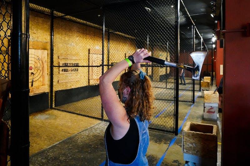 woman throwing an axe at Reno Axe