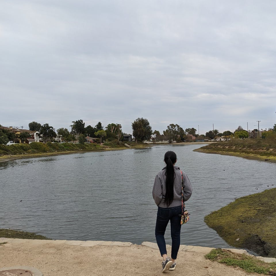 Woman standing and overlooking the Colorado Lagoon in Long Beach Los Angeles County