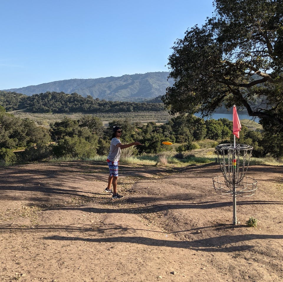 Person playing disc golf at Coyote Point Disc Golf Course at Lake Casitas Recreation Area near Ventura