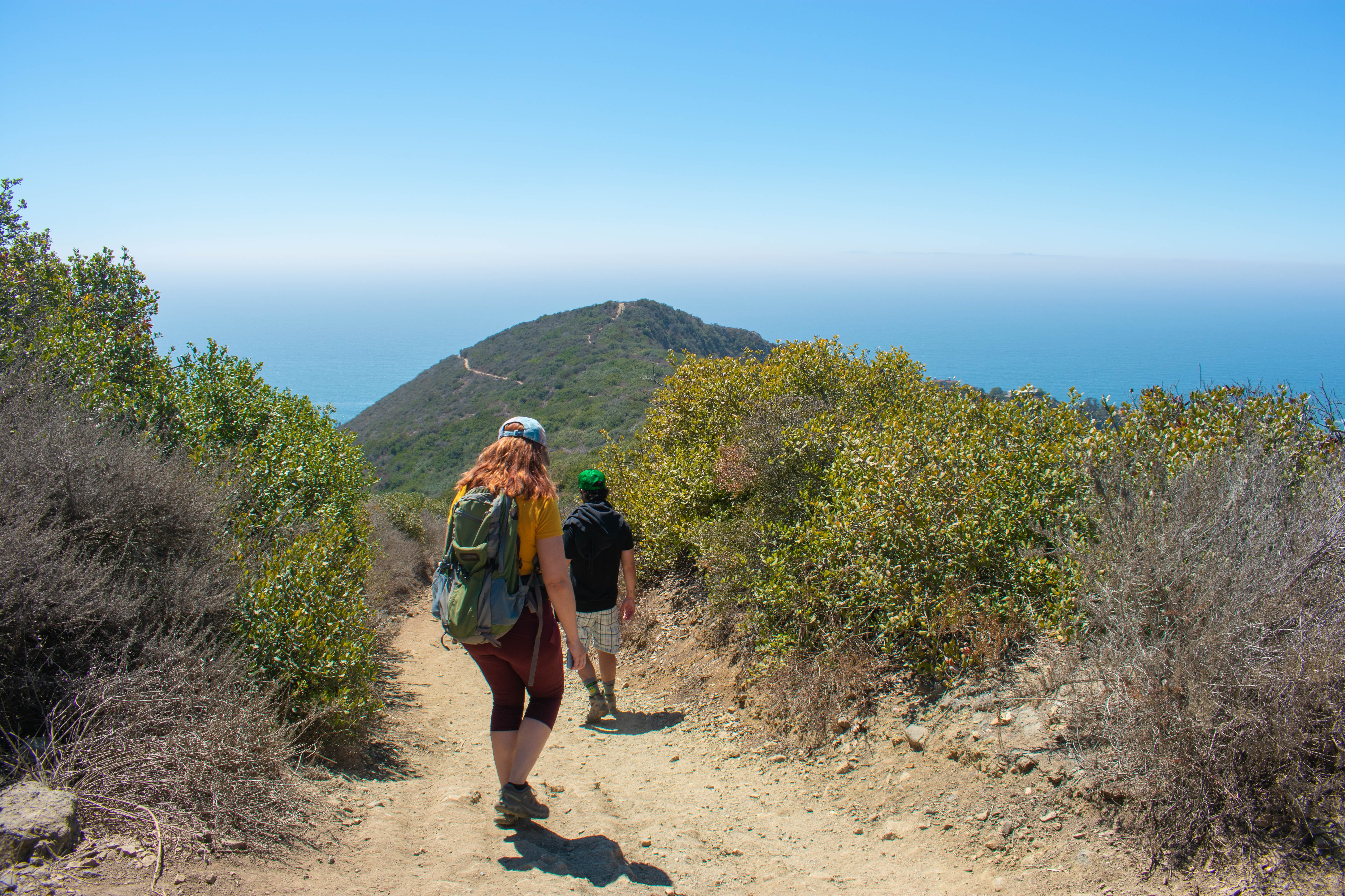 Hikers going down to Coast Royale Beach in Orange County