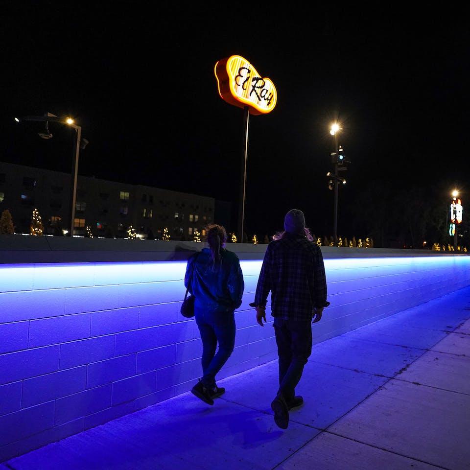 couple walking Neon Line in Reno