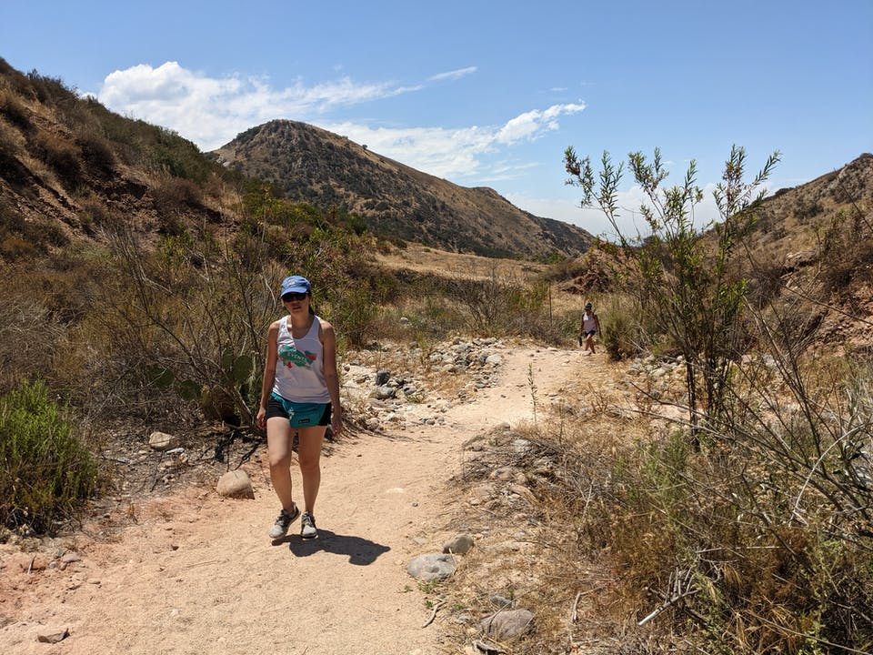 Woman hiking on Borrego Canyon Trail in Whiting Ranch Wilderness Park in Orange County