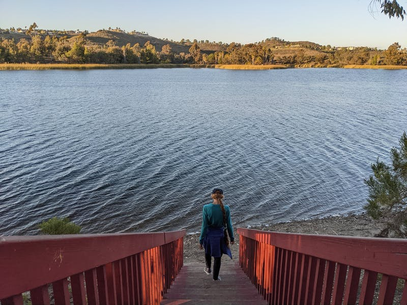 Woman hiking down stairs at Lake Miramar in San Diego County