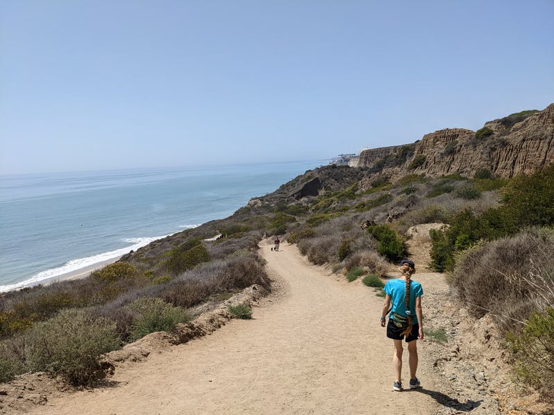 Woman hiking the San Onofre Bluffs Loop Trail to San Onofre State Beach in San Diego County