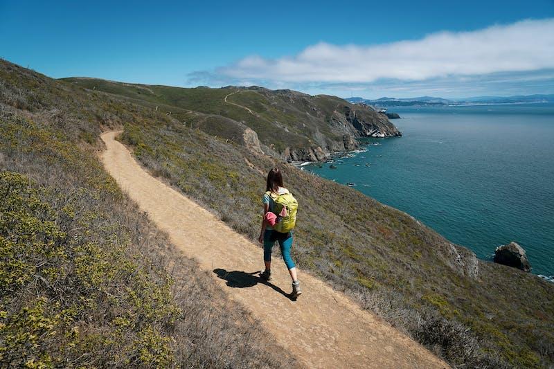 Woman hiking the Coastal Trail in the Marin Headlands