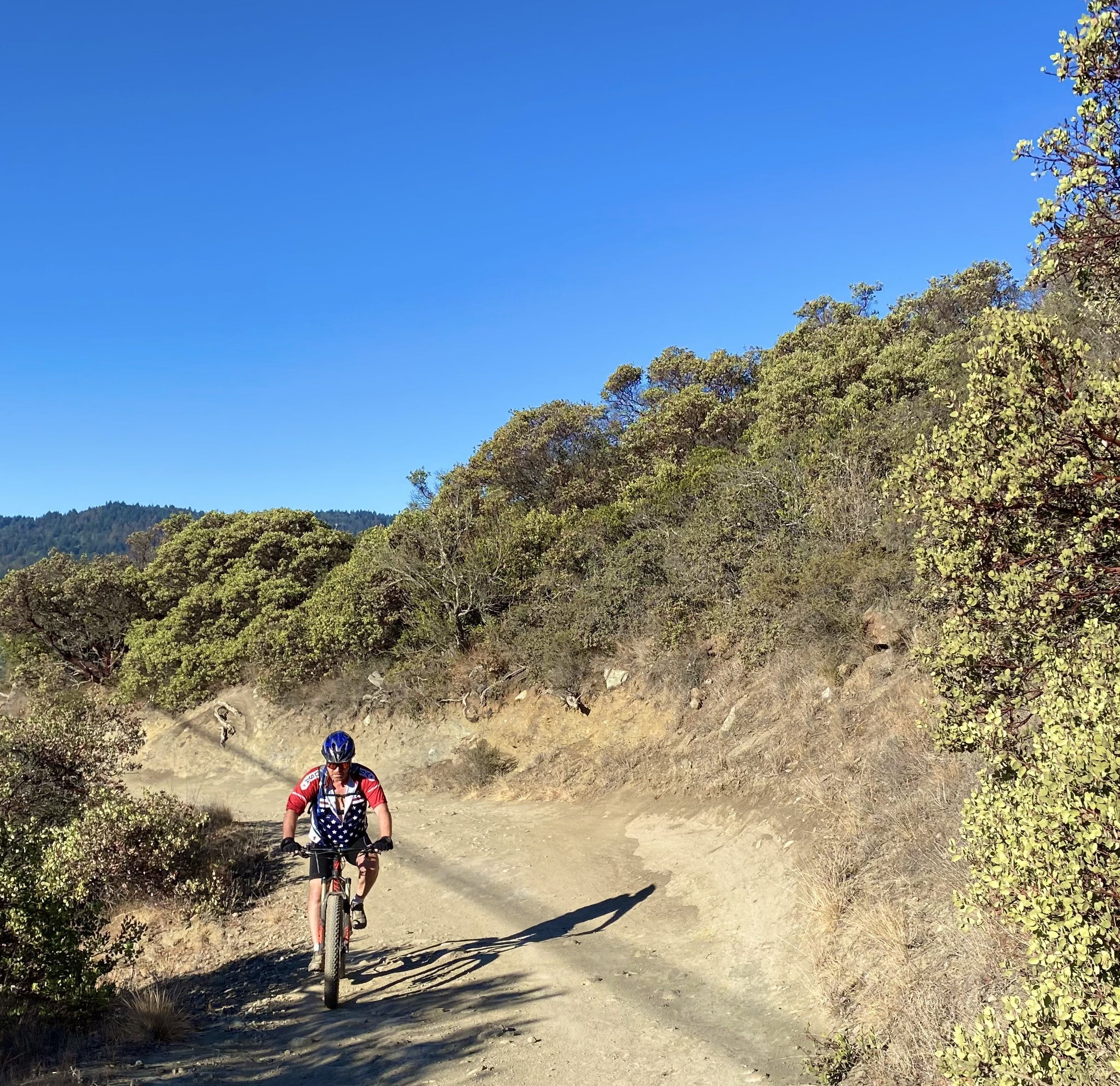 Mountain biker going up a trail at St. Joseph's Hill in Los Gatos