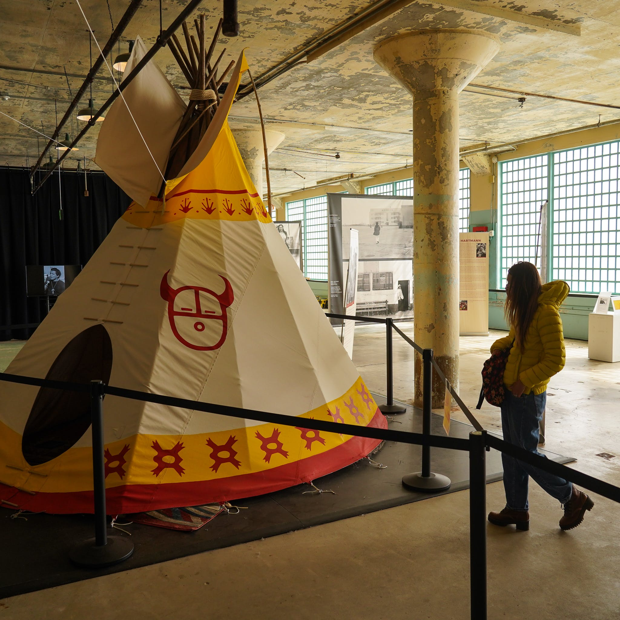 Woman looking at a teepee installation at the Red Power On Alcatraz exhibit on Alcatraz Island
