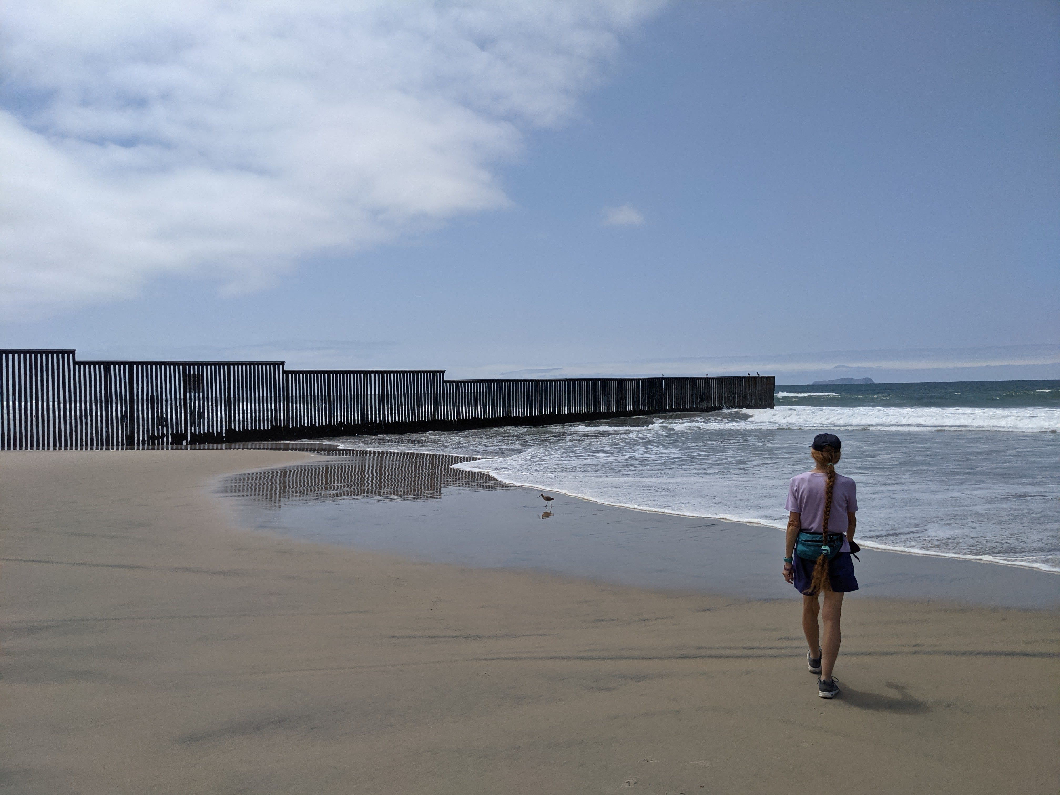 Woman walking on the beach at Border Field State Park in San Diego County