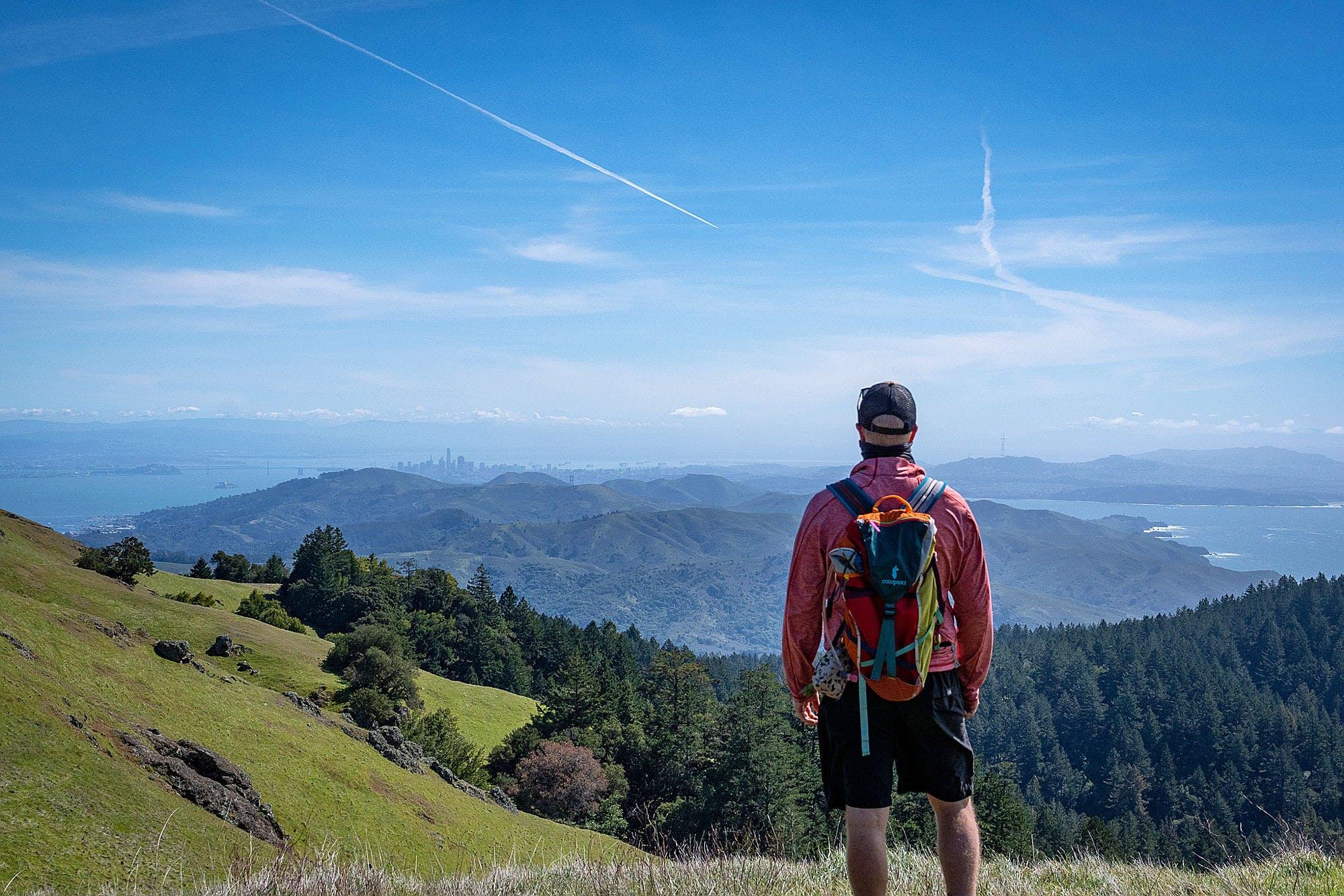 Man standing at Mount Tam vantage overlooking the San Francisco skyline