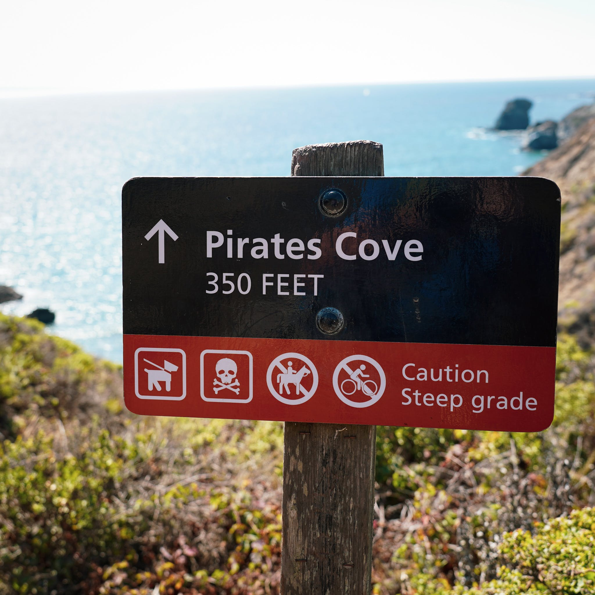 Sign pointing the way to Pirates Cove beach in the Marin Headlands