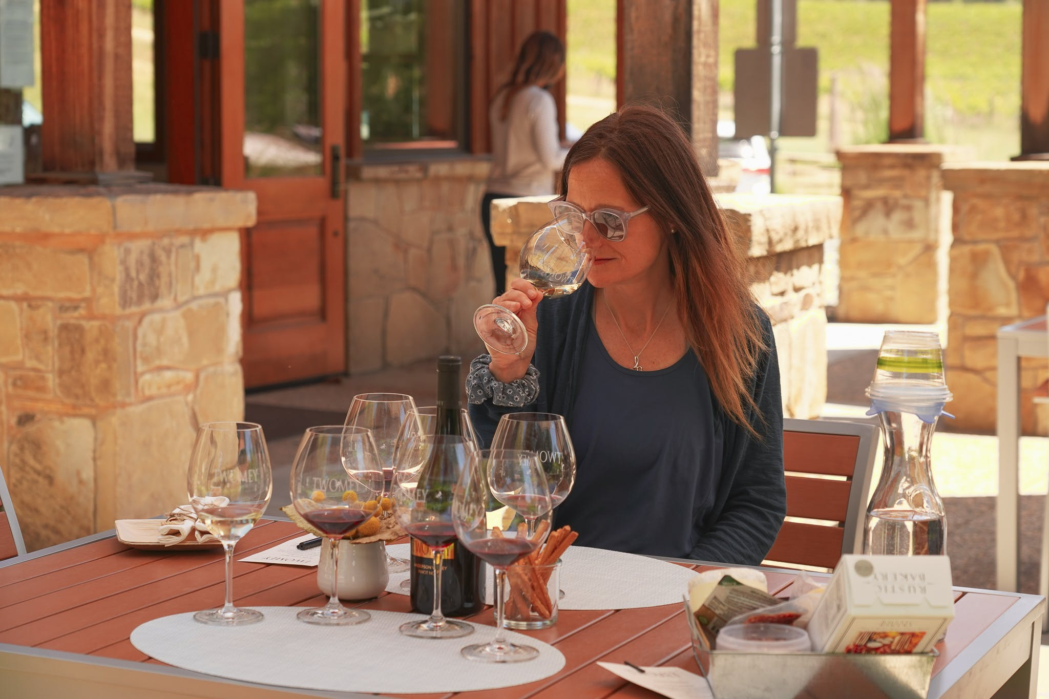 woman wine tasting in Anderson Valley at Twomey