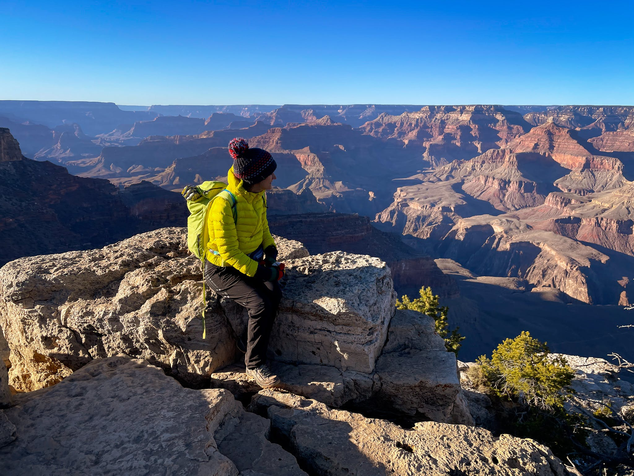 woman at sunset on rim of Grand Canyon