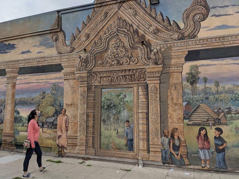 Woman looking at mural art in Long Beach