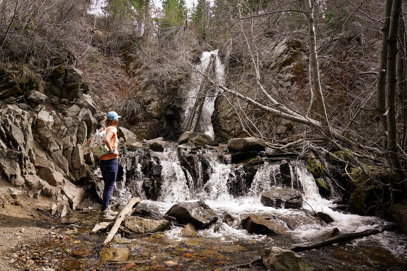 hiker at Hunter Creek Falls in Reno