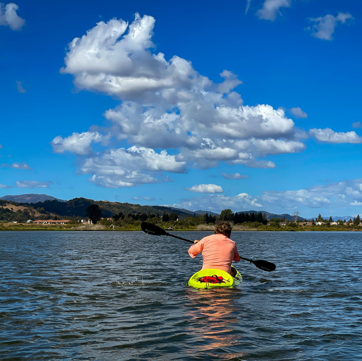 Kayak paddler on the Napa River via a Napa Valley Paddle adventure