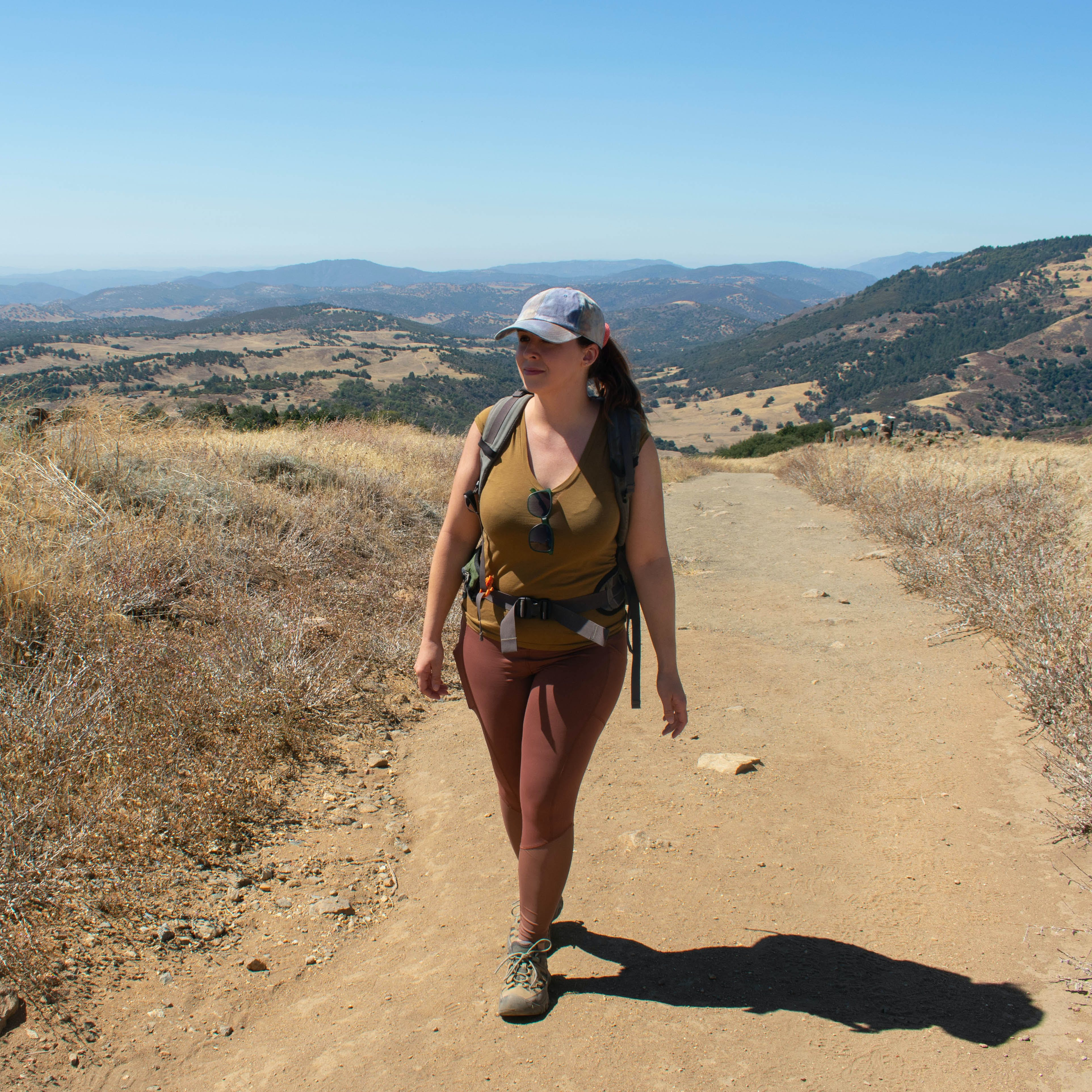 Hiker on a wide dirt trail at Volcan Mountain near Julian in San Diego County