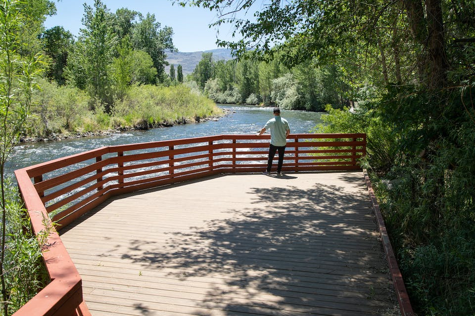 Man looking at Truckee River in Reno Oxbow Nature Study Area